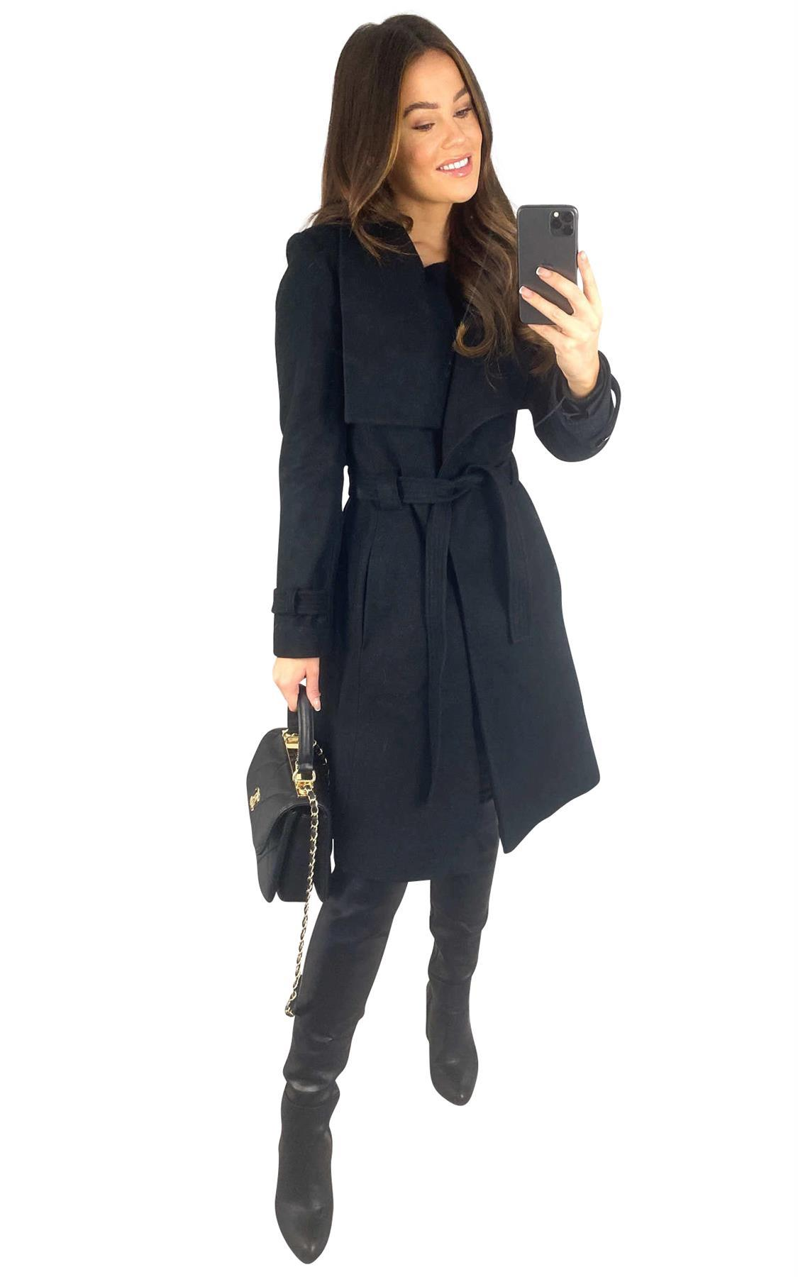 A Wrap Winter Coat With Stud Fastening.The Coat Has A large Collar, Tie Belt And 2 Pockets